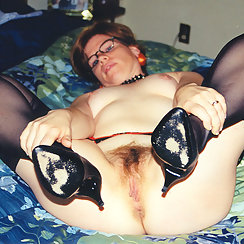 Nerdy Gal Lifts Her Legs And Shows Hairy Pussy