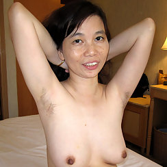 Asian Woman Flaunts Her Hairy Arm Pits