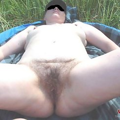Chubby Babe Lays Outdoors And Shows Us Her Hairy Pussy