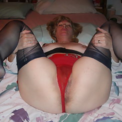Wearing Red Panties, Hot Mature Babe Shows Hairy Pussy Too