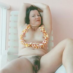 Gorgeous MILF Shows Off Hairy Pussy And Big Tits